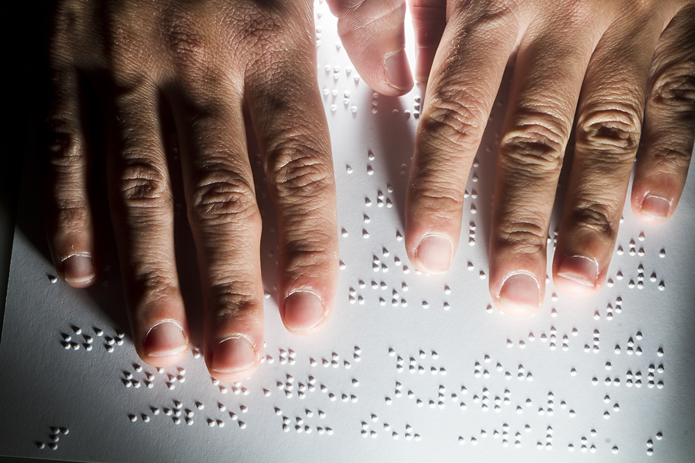 Blind reading text in braille language